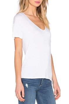 This super soft & draped tee is the perfect palate cleanser of white to add some freshness to your spring style. The top features a flattering wide V-neck, centre back keyhole opening with a drop sleeve shoulder. The fit is slightly boxy to create a lady like swing in the fabric. This is a great travel piece because it folds up small and can be worn with almost anything.   Keyhole Back Tee by Splendid. Clothing - Tops - Tees & Tanks Canada