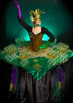 Book our Carnival Living Champagne Table. Hire our masquerade-themed human table for Mardi Gras-themed events, masquerade-themed events or corporate functions in the UK & London.