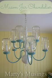 Convert an old chandelier to a mason jar chandelier....buy one at the thrift store. I might have to take it apart and turn the arms over. Very doable.