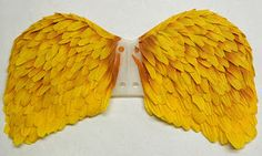 Deanna Hogan; I've made a set of wings for a doll, using a simple wing shaped piece of plastic and silk flower petals.