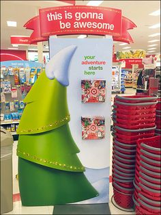 "Target® tells you ""This is gonna be awesome"" right at the door with this Christmas Season Toy Catalog display. See That stacks and stacks of shopping carrys are offered because you just know your g..."