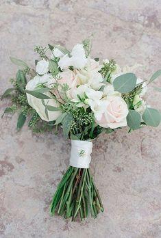 roses ranunculus hydrangea and eucalyptus wedding bouquet