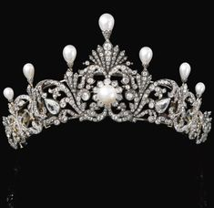 A substantial, natural pearl, belle epoque tiara, circa 1890, formerly the property of a Nobleman. A foliate scroll design, topped with seven natural pearls, with pear-shaped diamonds at the centre of each scroll; and a button-shaped pearl in the centre cluster of diamonds. This piece fetched CHF 206,500 at Sotheby's auction on 12th November 2012.