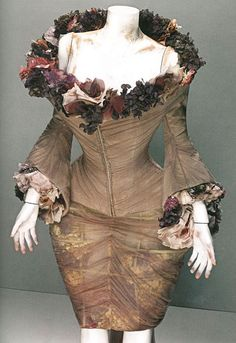 4. b) Margaret Cameron: corset, extravagant neckline, detailed with ruffles and flowers, with a wide set pannier inspired bottom half.