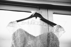 Coat hanger for the bride, love the wire detail with the lace ribbon and wood