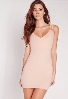 Strap yourself in for a night to remember in this sassy little number. Nude is the hottest shade around and there's no better way to dress it up than in a cute bodycon mini. Style yourself right with a pair of barely there heels and an embe...