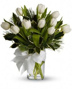 """Tulips and Pine Bouquet   T12Z114A      For a wintertime bouquet that's as pure as the driven snow, send this unexpected gift of ten tulips, accented with aromatic white pine, and adorned with a silver ribbon. A simple pleasure for a peaceful season.     Approximately 13 1/2"""" W x 14 1/2"""" H   https://www.4165flower.com/index.asp?pid=4=viewproduct=10342=1"""