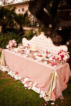 Wedding- DIY Wedding Dessert Table Ideas and Decorations. Looks like a fancy highback couch or head board could be used. Small table covered in pretty cloth with flower petals sprinkled around. Pretty pink them here.