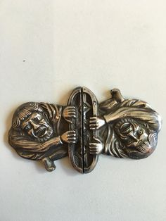 Gustav Gaudernack design for own workshop. Silver clasp with gargoyle motif from Trondheim cathedral. ca 1905-1914
