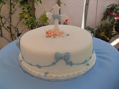 Baptism Cake - This is just so pretty I had to repin it. There is a tiny baby at the foot of the cross.