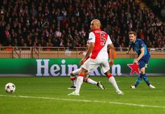 Aaron Ramsey of Arsenal (R) scores their second goal during the UEFA Champions League round of 16 second leg match between AS Monaco and Arsenal at Stade Louis II on March 17, 2015 in Monaco, Monaco.