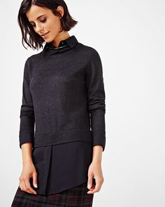 This preppy sweater is right on trend for fall. Try styling yours with a slim…