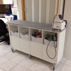 Ironing cart on wheels! IKEA hack - Kallax shelf with custom iron board on top.