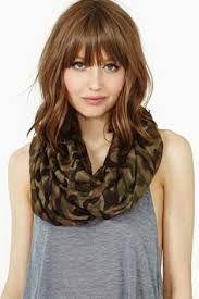 front bangs shorter wavy hair  brunette