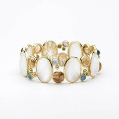Elizabeth Showers: 18kt yellow gold large Madeleine Cuff featuring faceted white quartz over  mother-of-pearl, rutilated quartz, and faceted london blue topaz over mother of pearl