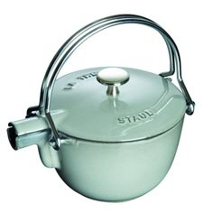 The Staub Round Teapot Kettle in Graphite is a stunning stove to table presentation and keeps your tea/water hot for up to an hour. The included stainless-steel mesh ball lets you brew loose tea without any hassle. Traditional Teapots, Enameled Cast Iron Cookware, Cocinas Kitchen, Cafetiere, Kitchen Gadgets, Kitchenaid, A Table, Tea Time, Sweet Home