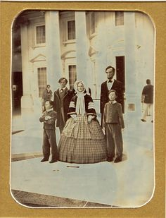 Museum wax figures of President Abraham Lincoln and his family (Tad, Robert, Mary, Abraham, Willie) photomontage in front of the White House