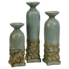 Three-piece blue ceramic candleholder set inspired by Grecian columns.   Product: Small, medium, and large candleholderConstruction Material: CeramicColor: BlueAccommodates: (1) Pillar candle each - not includedFeatures: Inspired by the columns of Ancient GreeceDimensions: 12 H x 4 Diameter (large)