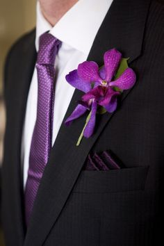 Fuchsia and purple mokara orchid boutonniere. Orchid Bridal Bouquets, Tropical Wedding Bouquets, Wedding Cake Fresh Flowers, Bride Bouquets, Bridesmaid Bouquet, Floral Wedding, Orchid Boutonniere, Groom Boutonniere, Boutonnieres