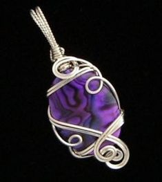 Purple paua shell and sterling silver wire pendant by Rena Klingenberg