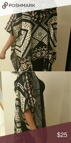 "NWOT NEW WITHOUT TAGS Hooded GEO poncho. A Knit Hooded Poncho Featuring An Allover Geo Pattern, 3/4 Dolman Sleeves, An Open Front, And A Tasseled Hem. Content + Care - 57% Acrylic, 36% Cotton, 7% Nylon  - Hand Wash Cold   Size + Fit - Model Is 5'9"" And Wearing A Small  - Full Length: 37""  - Chest: 64""  - Waist: 64""  - Sleeve Length: 18"" Sweaters Shrugs & Ponchos"