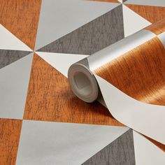 Grab a sample of this and frame it for the kitchen?   Colours Mosaic Copper, Navy & Pewter Geometric Metallic Wallpaper | Departments | DIY at B&Q