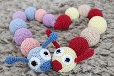 20 #Crochet Snails, Caterpillars, Slugs and Worms - patterns and inspiration including this teething ring sold on Etsy by ZanesCrochetTreasure