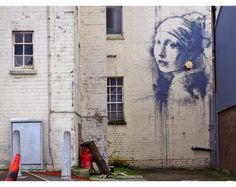 "Banksy paints ""The Girl With Pierced Eardrum"" at the Dockside Studios in Bristol, UK '14 ~ inspired by Jan Vermeer's masterpiece. the piece is located on unit15,Albion Dockside Estate, Hanover Place, Bristol"