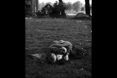 """The Family of Man""   An American soldier kissing his English girlfriend on the lawn in Hyde Park, one of the favorite haunts of US troops stationed in England, 1944, by Ralph Morse"