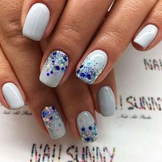 The Sequenced Summer Nails. Rock up your boring white nails with the blue glitters and sequence and add fun to your summer holidays.