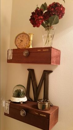 Cigar boxes used as floating shelves