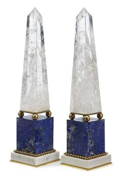 Pair of Continental gilt metal mounted rock crystal, lapis lazuli, and marble obelisks ; 20th century. The rock crystal obelisk raised on four gilt metal balls, above a lapis lazuli plinth, raised on a white marble base - Dim: H: 15 1/4 in.
