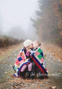 cute kids wrapped in a blanket