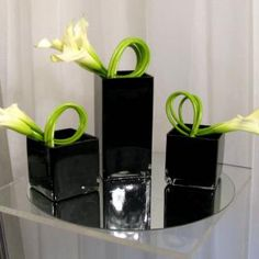 Here are some photos of our Art Deco inspired centerpieces.  We used black square and rectangular vases to add slick look to the arrangements. Softly twisted white callas truly represent the definition of art deco. They display an eclectic form of elegant and stylish modernism.