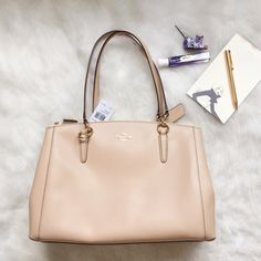 🎉WEEKEND WEAR HP🎉Coach Christie Carryall- Nude We found it- the perfect bag! It's a great neutral, and HIGHLY functional. Two zipper compartments, and an additional in the middle. Crossbody strap included. Crossgrain Leather. 14.5x10.5x4.5 Coach Bags Satchels