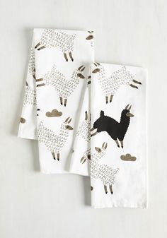 With these playfully printed tea towels prepped for quick cleanup, you're ready to whip up your most exciting treat yet! Decorated with grey and black prancing alpacas, this cotton-linen-blend set serves up a sizable portion of panache that aims to enliven even your most spiced-up recipe.