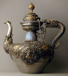 century teapot, Tibet, solid silver with gilding and turquoise inlay,