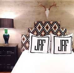 Dark surfaces and colors, mixed with natural tones. Like the covered headboard & indents/design. Monogrammed pillows, simple linens ~k