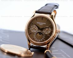 European Watch Company: Patek Philippe Perpetual Calendar in 18K Rose Gold with an beautiful brown dial.....