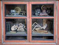 A fun display in one of my favorite cupboards. Skeleton by Scott Smith of Rucus Studio © Boxes by Roberta Taylor, doll by Christine Crocker, pin cushion by Nicol Sayre Halloween Arts And Crafts, Halloween Skeletons, Halloween Stuff, Vintage Halloween, Fall Halloween, Halloween Ideas, Halloween Decorations, Halloween Party, Halloween Costumes