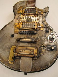 love stuff that is also art. this looks like a post-Apocalypse guitar.