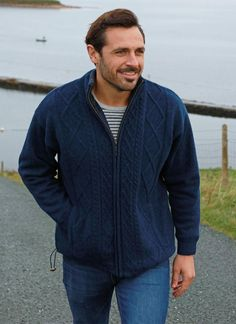 Heritage Zip Cardigan in Navy: Made from 100% shetland wool for natural warmth and insulation, our heritage zip cardigan has cotton lining and a fleece lined collar. The front has traditional stitching with plain knit back and sleeves and two front pockets. The drawstring can also be pulled at the hem for a snug fit. #menswear #style #fashion #knitwear #cardigan #MensStyle #GiftsForHim #AranSweater #Knit #Wool #CableKnit#MensSweater #MensFashion #Ireland #FishermanSweater #Traditional #Irish