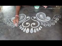 Laxmi puja special beautiful Laxmi pa door alpona design/Mukesh arts - YouTube Rangoli Side Designs, Simple Rangoli Border Designs, Rangoli Designs Latest, Free Hand Rangoli Design, Small Rangoli Design, Rangoli Patterns, Colorful Rangoli Designs, Rangoli Ideas, Rangoli Designs Diwali