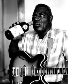 Howlin' Wolf, looking ready to eat broken glass as he washes it down with Ancient Age bourbon.