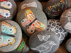 painted rocks for the garden. you can also do this by heating the rocks, then painting with crayon.. it melts on it.
