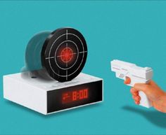 Gun O Clock Aims For Your Wakefulness | Ubergizmo - It won't stop ringing until you hit the target I NEED THIS xD