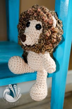 This little cuddly lion is as sweet as can be, not a ferocious King of the Jungle! Your child will certainly love him and his fluffy mane!  Specifications:      -100% hand crocheted in a smoke free home in the USA.      - 8 inches tall.      - Made with acrylic yarn, fiberfill and safety eye...