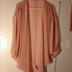 Soft pink kimono robe From urban outfitters. New condition. New without tags. Soft pink color. Urban Outfitters Tops Tunics
