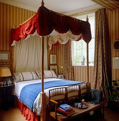 Bedroom, classic striped walls and canopy bed with bench at end of bed