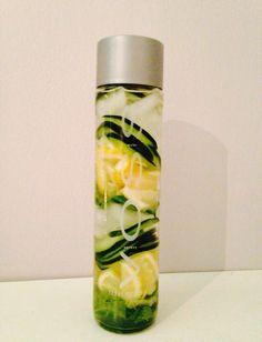 Cucumber mint lemon water in a voss bottle